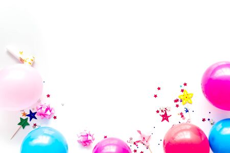 Decorative frame with colorful balloons on white background top-down frame copy space