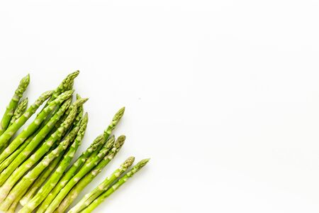 Asparagus steams frame on white background top-down copy space Archivio Fotografico