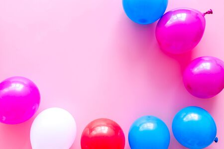 Decorative frame with colorful balloons on pink background top-down frame copy space