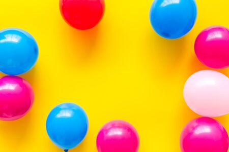 Colorful balloons frame on yellow background top-down frame copy space 写真素材