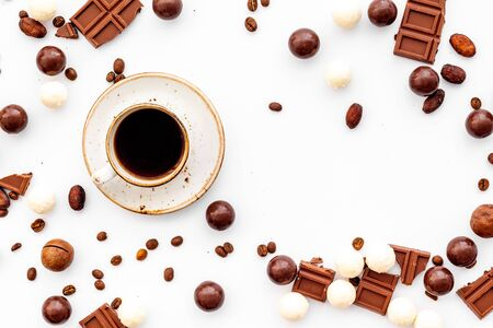 Candy background with chocolate and coffee on white background top view. Stock Photo