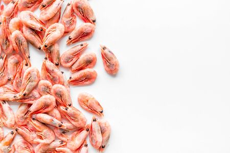 Shrimps background on white table top view frame copy space