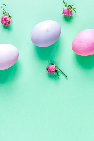 Easter concept on green background top view mockup