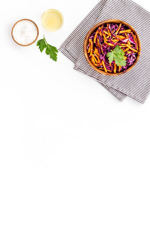 Healthy vegan salad with red cabbage on white kitchen table top view copy space