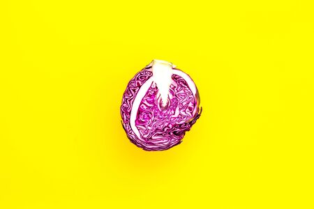 Red cabbage - head, cross section - on yellow background top view copy space
