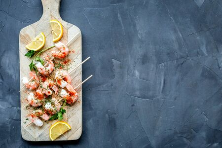 Shrimp skewers - seafood - on grey table top view copy space