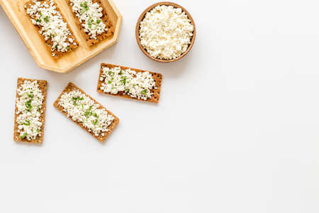 Cottage cheese toast on white desk top view copy space