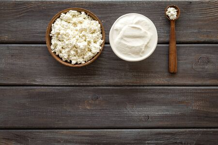 Cottage cheese in bowl with spoon - for breakfast - top view copy space