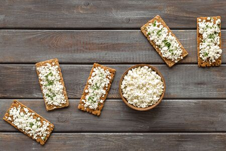 Toasts with cottage cheese and greenery for breakfast from above Stok Fotoğraf