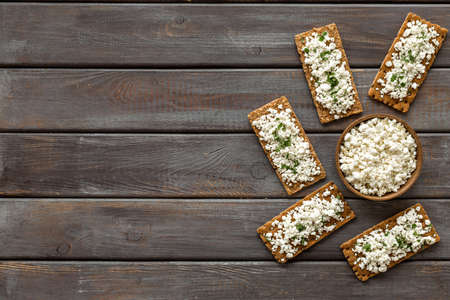 Cottage cheese toast on wooden desk top view copy space Stok Fotoğraf