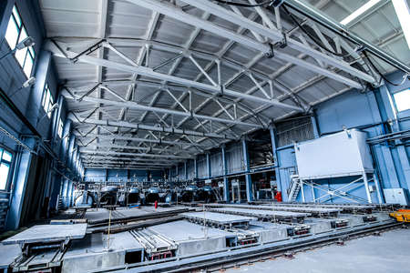 factory premises with opened autoclaves for concrete blocks production with rail and trolley panoramic view Archivio Fotografico
