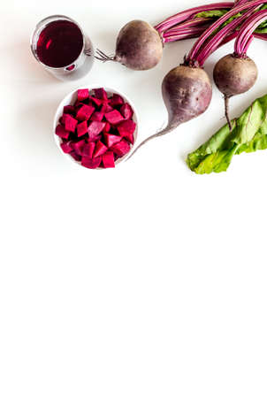 Beet - slices, fresh juice, green tops - from above copy space.