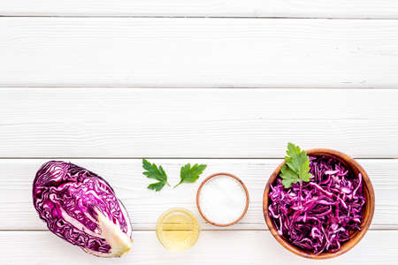 Red cabbage - coleslaw, cold-slaw - on white kitchen desk top-down. Reklamní fotografie