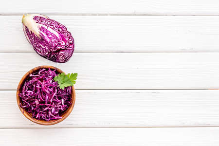 Red cabbage - coleslaw, cold-slaw - on white kitchen desk top-down. 스톡 콘텐츠