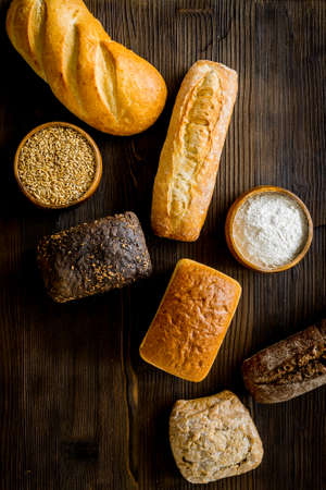 Bakery. Fresh bread in assortment on table top-down