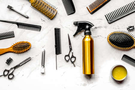 hairdressing concept with barber tools on white background top view