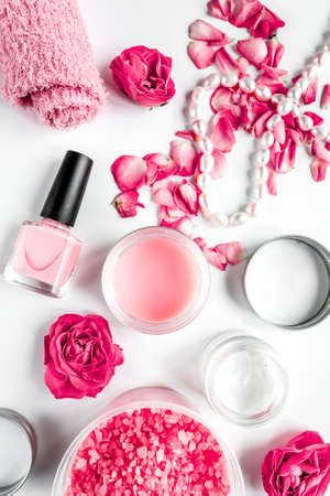 organic cosmetic with rose cream on white background top view