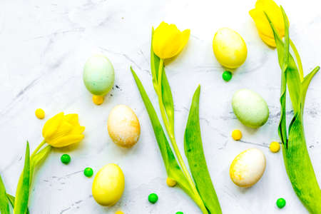 Easter concept eggs with tulip top view pattern Reklamní fotografie