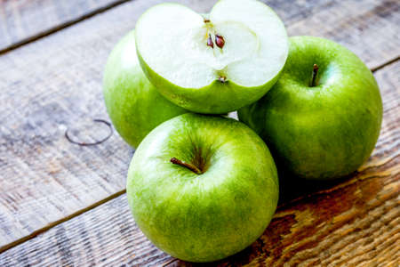 green apples for healthy dessert on wooden background Archivio Fotografico