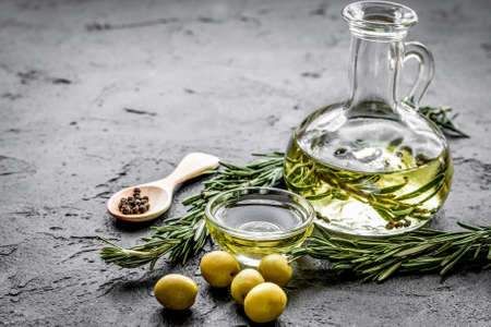 olive oil with ingredients on kitchen table background mockup