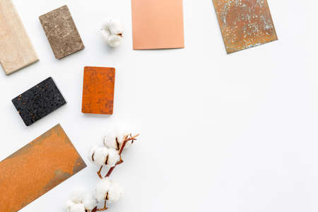 Color scheme with samples of material - kitchen countertops and wooden cabinet. Flat lay Foto de archivo