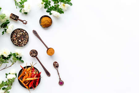 Various aromatic and hot spices with herba and flowers, view from above 免版税图像