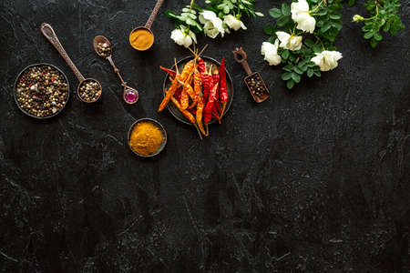 A set of fragrant hot spices - pepper and paprika with herbs, top view