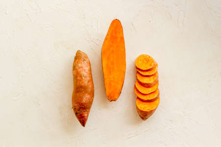 Sliced sweet potato on kitchet table, top view Archivio Fotografico