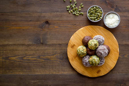 Vegen energy balls with pumpkin seeds and coconut, overhead view