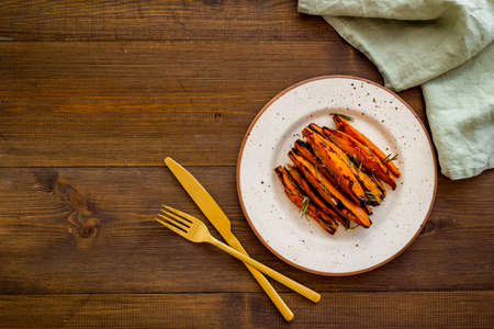Homemade baked sweet potato - fries with spices, top view