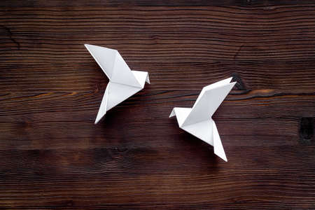 Origami pigeon. World Peace Day, care concept. Top view