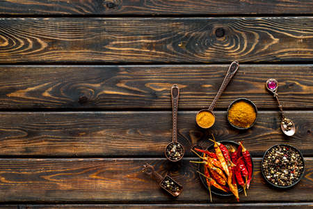 Overhead view of hot spice. Red pepper and paprika with cooking utensils Archivio Fotografico
