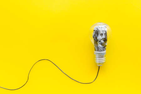 Money in light bulb - renewable eco energy concept Archivio Fotografico