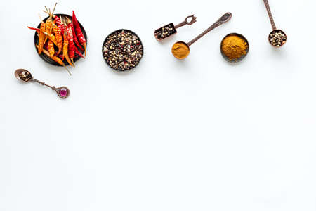 Hot spices and aromatic herbswith cooking utensils overhead