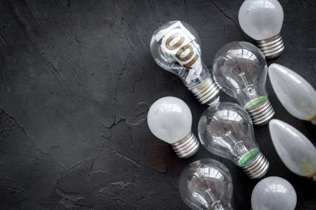 Light bulb with money inside - business plan and idea concept