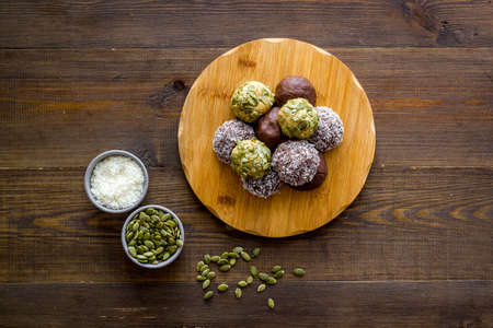 Raw energy balls with coconut and pumpkin seeds, top view