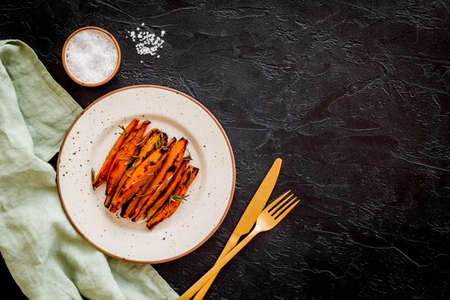 Overhead view of sweet potato fries with spices and herbs