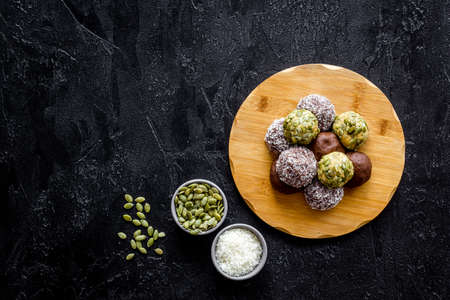 Energy protein balls with ingredients, top view