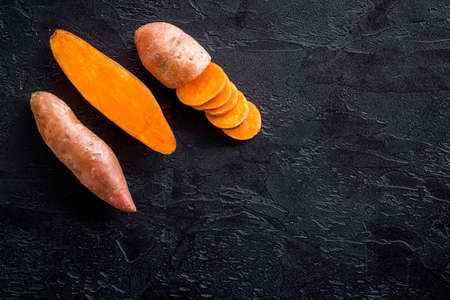 Layout of sweet potatoes. Organic vegetables background, overhead view