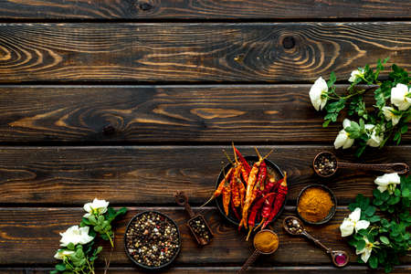Various aromatic and hot spices with herba and flowers, view from above Archivio Fotografico