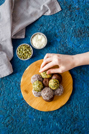 Top view of raw vegan energy balls with nuts and cacao