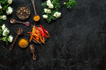 Set of hot Indian spices with flowers, top view