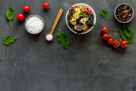 Italian colorful pasta with tomatoes and fresh basil, top view Stock fotó