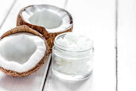 coconut oil for body care in cosmetic concept on white desk mock up Archivio Fotografico