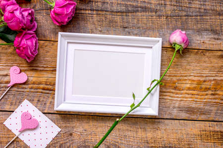 Present for woman with peony, frame, hearts top view space for text