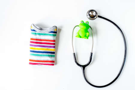 Pediatrics equipment with toys, stethoscope white background top view space for text