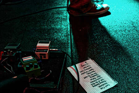 Stage with guitar pedals and set list