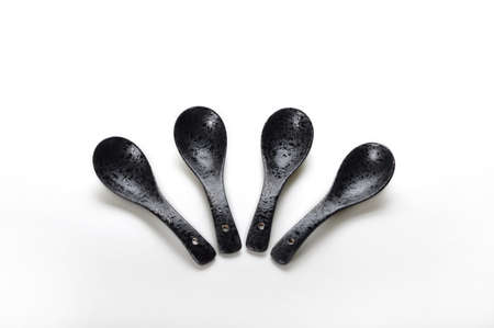 finery: 4 Black ceramic spoon Stock Photo