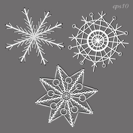 Three white snowflakes Set of three snowflake-style paper vector illustration
