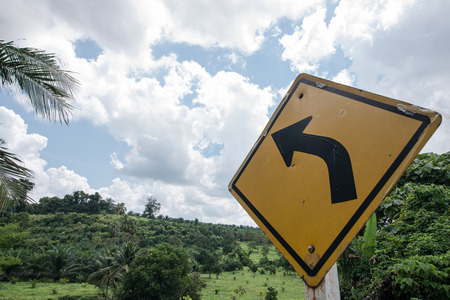 turn left sign: Turn left sign to deep into valley Stock Photo
